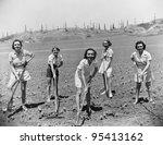 Portrait of women digging in field - stock photo