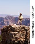 man facing camera on rocks of... | Shutterstock . vector #9554839