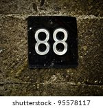 numbers 88 on old stone wall. | Shutterstock . vector #95578117