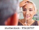 close up of female face being... | Shutterstock . vector #95618707