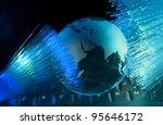 computer data concept with earth globe against fiber optic background - stock photo