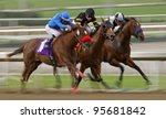 ARCADIA, CA - FEB 19: Jockeys struggle for the lead in the 6th race at Santa Anita Park in Arcadia, CA, on Feb 19, 2012. - stock photo