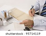 young man working on table with ... | Shutterstock . vector #95714119