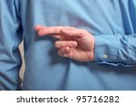 Lying businessman. Businessman in black shirt crossing his fingers behind his back - stock photo