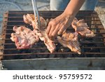hand keep pork on barbecue | Shutterstock . vector #95759572