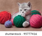 Stock photo lovely kitten with balls of threads 95777416