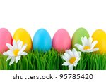 Easter colored eggs on the green grass. - stock photo