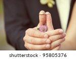 wedding rings on her fingers... | Shutterstock . vector #95805376