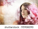 Beautiful Girl in Elegant Pink Flower Background - stock photo