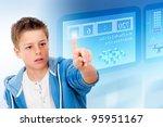 Young student with virtual futuristic interface simulating digital blackboard. - stock photo