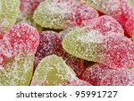 Sour Cherry Sweets - Close-up of fizzy cherry flavoured gums. - stock photo
