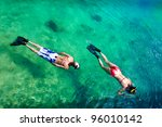 Young Couple Snorkeling In...