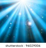 Bright blue light rays shining down with lens flare background - stock photo