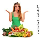 Young smiling woman with variety of fresh vegetables and fruits isolated on white - stock photo