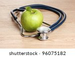 medical stethoscope and green