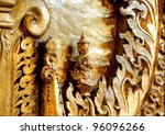 golden little piece of artwork in a temple in Myanmar - stock photo