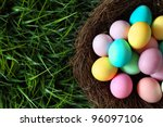 Colorful Easter Eggs In Nest O...