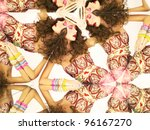 Bright young brunette in kaleidoscope of reflections - stock photo