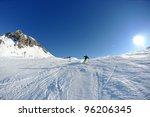 Skier Skiing Downhill On Fresh...