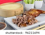 Peking Duck - Chinese roast duck served with pancakes, cucumber, spring onions and hoisin/plum sauce. - stock photo