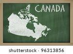 drawing of canada on blackboard, drawn by chalk - stock photo