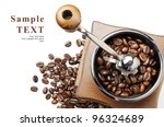 Old coffee grinder and coffee beans on white background with space for your text - stock photo