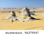 Typical landscape in the White desert, Sahara, Egypt. Sand and unusual limestone formation - stock photo