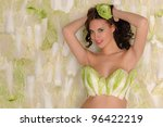 Happy beautiful pregnant woman in lingerie from cabbage - stock photo