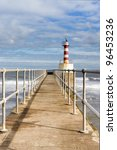 Small photo of Amble harbour lighthouse / Lighthouse at the end of Amble harbour pier