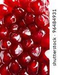 Background of ripe grains pomegranate on white - stock photo