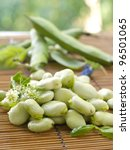 Fresh green soybeans with flower, selective focus - stock photo