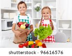 Healthy eating education - kids with vegetables in grocery bag - stock photo