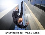Businessman Falling From A Tal...