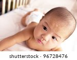 a cute asian baby laying... | Shutterstock . vector #96728476