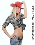 The beautiful girl in a cowboy's hat - stock photo