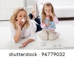 Would you care for a cup of tea - woman and little girl playing - stock photo