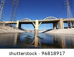Sixth Street Viaduct from LA River/View of Sixth Street Bridge from within the Los Angeles River - stock photo