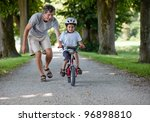 father teaching his son to ride ... | Shutterstock . vector #96898810