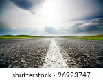 High speed road with cloudy sky background - stock photo