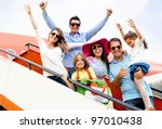 excited family with arms up... | Shutterstock . vector #97010438
