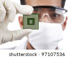 Scientist holding a microchip computer - stock photo