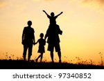 happy family on meadow at...   Shutterstock . vector #97340852