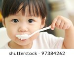 toddler girl feeding herself... | Shutterstock . vector #97384262