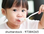Toddler Girl Feeding Herself...