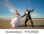 Happiness jump of married couple - stock photo