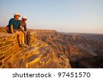 Couple in Fish canyon in Namibia - stock photo
