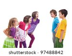 Kids confronting and mocking each other - girls and boys apart - stock photo