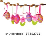 easter border with hanging colorful eggs and  felt flowers isolated on white - stock photo