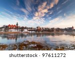 Malbork city with frozen Nogat river, Poland - stock photo
