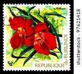 Small photo of BURUNDI - CIRCA 1973: A stamp printed in Republic of Burundi shows tropical flowers (Miltonia), circa 1973